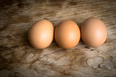 Eggs on wood background Royalty Free Stock Photos