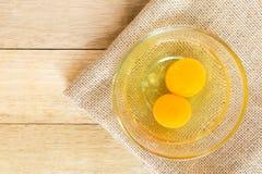 Eggs on wood background Stock Image