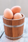 Eggs in wood bucket Royalty Free Stock Image