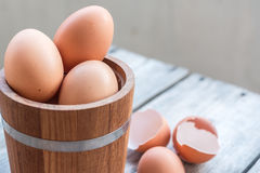 Eggs in wood bucket Royalty Free Stock Images