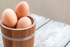 Eggs in wood bucket Stock Image