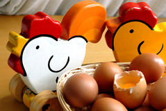 Eggs and wood chickens Royalty Free Stock Image