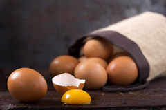 Eggs on wood Stock Images