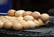Eggs into the wood on the stove. Stock Photography