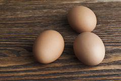 Eggs on wooden background. Eggs closeup on wooden background Stock Photo