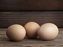 Eggs on wooden background. Eggs closeup on wooden background Royalty Free Stock Photo