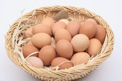 Eggs  on a wooden basket weave. Eggs are placed on a wooden basket weave on a white background Royalty Free Stock Images