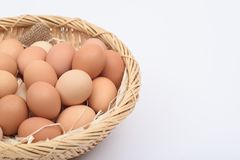 Eggs  on a wooden basket weave. Eggs are placed on a wooden basket weave on a white background Royalty Free Stock Photo