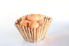 Eggs in wooden basket Royalty Free Stock Photo