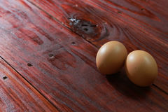 Eggs on wooden boards Stock Photography
