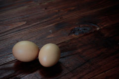 Eggs on wooden boards Stock Photo
