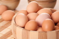 Eggs in wooden bowl Royalty Free Stock Photo