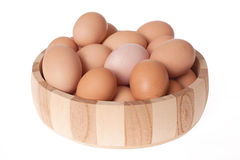 Eggs in wooden bowl Stock Photography