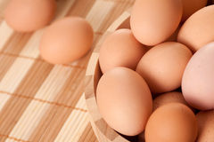 Eggs in wooden bowl Royalty Free Stock Photography