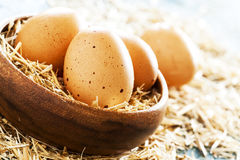Eggs in wooden bowl Royalty Free Stock Images