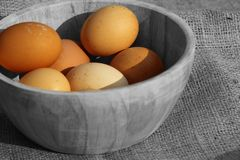 Eggs in a wooden bowl on hessian Stock Image