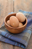 The eggs in wooden bowl Royalty Free Stock Photography