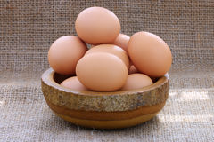 Eggs in wooden bowl Stock Images