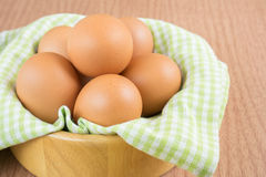 Eggs in the wooden bowl Stock Image