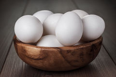 Eggs in wooden bowl on the table. Some eggs in wooden bowl on the table royalty free stock image
