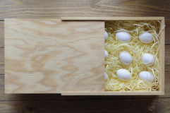 Eggs in a wooden box. Eggs in a wooden box on a soft substrate. Premium package Stock Photography