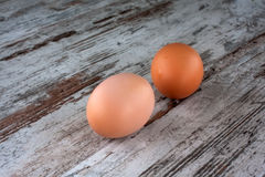 Eggs on the wooden floor. Two eggs on the wooden floor Stock Photography