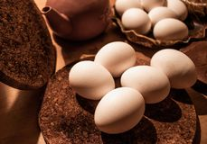 Eggs with a wooden background royalty free stock image