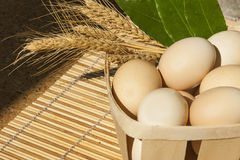 Eggs in wooden square Royalty Free Stock Photos