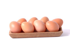 Eggs in wooden square bowl isolated white background Stock Photo