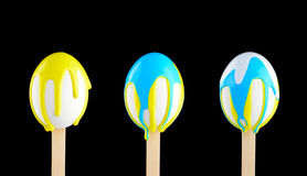 Eggs on a wooden stick doused with paint Stock Image