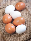Eggs on a wooden surface Royalty Free Stock Images