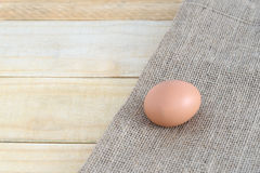 Eggs on wooden table background Stock Photo