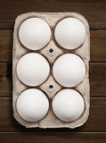 Eggs on wooden table. Royalty Free Stock Image