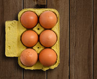 Eggs on wooden table. Stock Photos