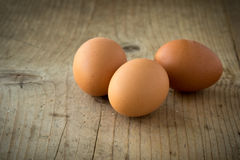 Eggs on wooden table Royalty Free Stock Image