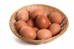 Eggs in woven basket Royalty Free Stock Photo
