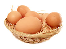 Eggs in the woven punnet Stock Photos