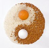 Eggs In Yan. Culinary composition of buckwheat, rice and eggs stock photos