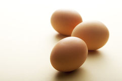 Eggs on yellow background Royalty Free Stock Images