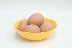 Eggs in the yellow bowl. Five eggs in the yellow bowl Royalty Free Stock Image