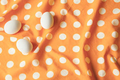 Eggs on yellow dotted cloth. Minimal. Top view. Royalty Free Stock Photo