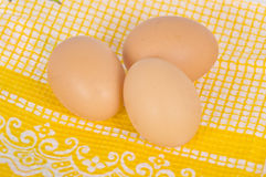 Eggs on yellow tablecloth Stock Image