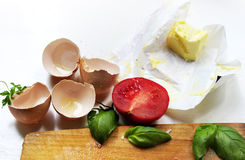 Eggshell and ingredients for preparing baked eggs Royalty Free Stock Image