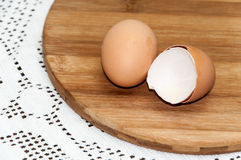 Eggshells on the kitchen wooden board Stock Image