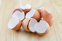 Eggshells on wooden table Stock Photography