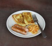 Eggy Bread, spaghetti and sausage breakfast meal Royalty Free Stock Images
