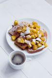 Eggy bread with stewed apples and coffee Stock Photos