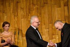 Egils Levits giving gift for Andris Vilks, director of LNB Latvian National Library