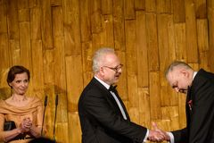 Egils Levits giving gift for Andris Vilks, director of LNB Latvian National Library royalty free stock photo