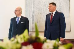 Egils Levits, Newly Elected President of Latvia and Raimonds Vejonis, Former President of Latvia, during Introduction ceremony in. RIGA, LATVIA. 8th of July 2019 royalty free stock image
